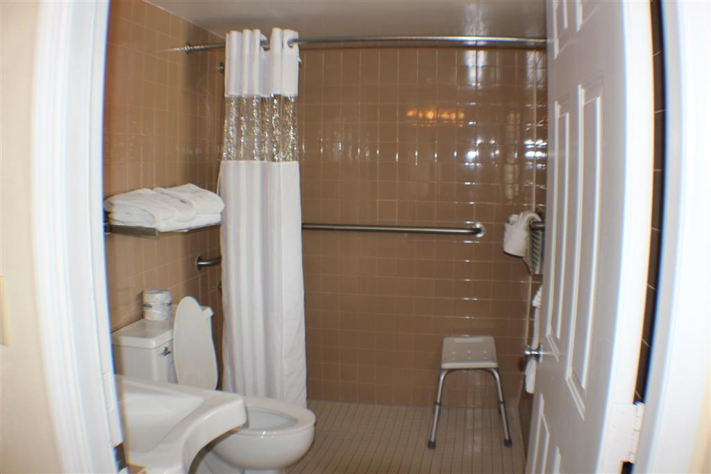 Best Western Hibiscus Motel - Large guest bathroom with ADA mobility accessible features includes a roll-in shower and second vanity area with a sink for your convenience.