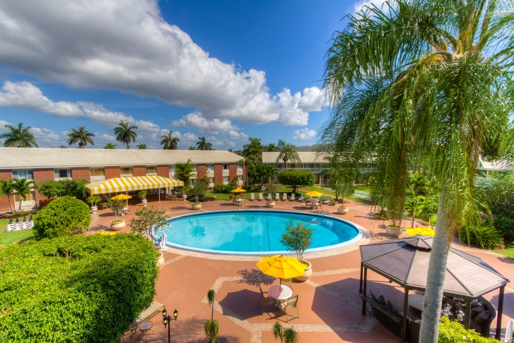 Best Western Palm Beach Lakes - Come and experience a taste of the real Florida. Enjoy our beautiful, spacious courtyard with an oversized heated pool and outdoor covered patio, picnic/BBQ area and plenty of space to enjoy the warm Florida sun.