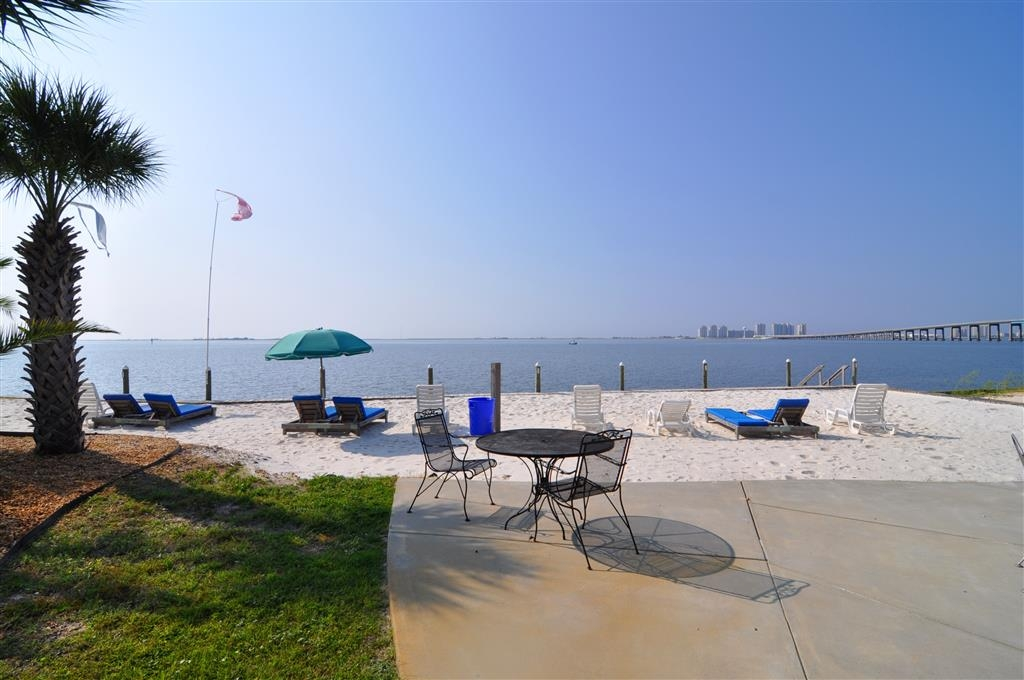 Best Western Navarre Waterfront - Rest and relaxation await you on our secluded beach.