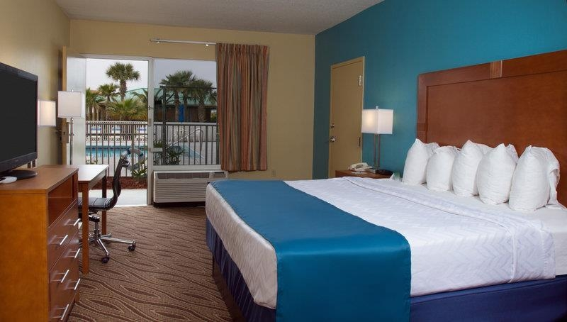 Best Western Navarre Waterfront - Relax after a long day of travel in our king guest room with a pool view.