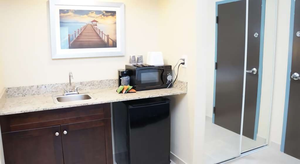 Best Western Naples Plaza Hotel - Our guest rooms come with mini refrigerator and microwaves as well as hair dryer, iron and ironing board.