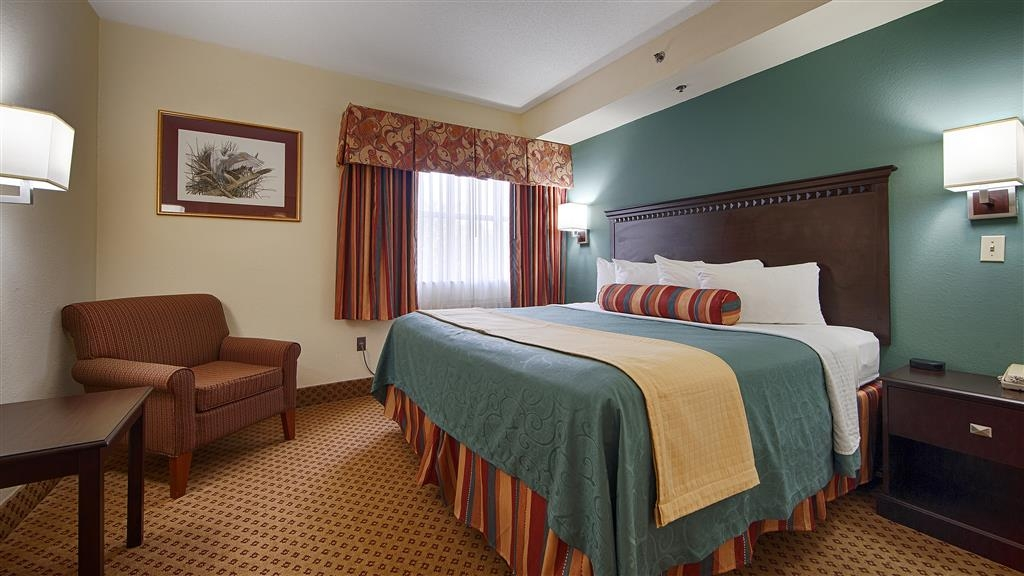 Best Western Gateway Grand - Relax after a long day of travel in our King Suite. Enjoy a confortable King size bed, a separate living room with a pull-out sofa, 43in Flat Screen TV, A wet sink with a Coffee Maker, Microwave and Refrigerator