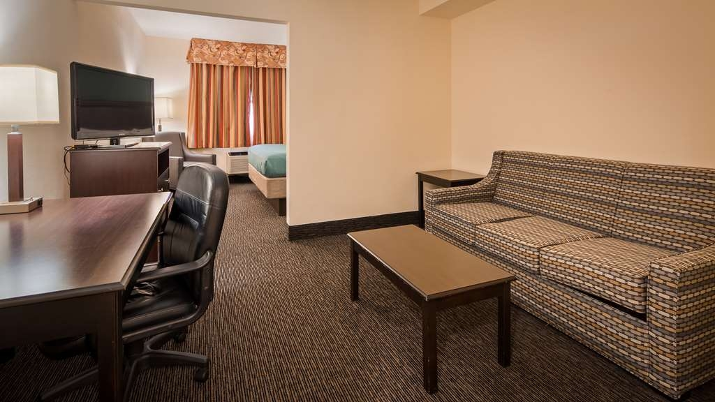 Best Western Gateway Grand - Our King Suite include 1 king size bed, Sitting area with a pull-out sofa. a wet bar with a microwave and refrigerator.