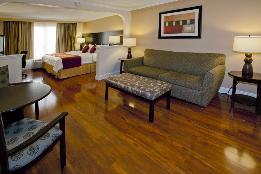 Best Western Plus Ambassador Suites Venice - King Suite with Laminate Floors. You'll fall in love with the clean and comfortable look of these hard floors.