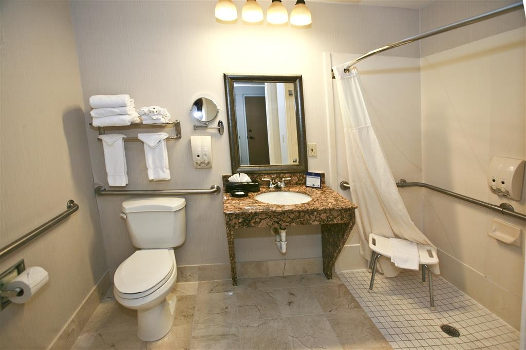Best Western Plus Ambassador Suites Venice - ADA Mobility Accessible Bathroom. Large suites with walk-in shower, furniture that is conveniently placed for easy movement throughout suite.