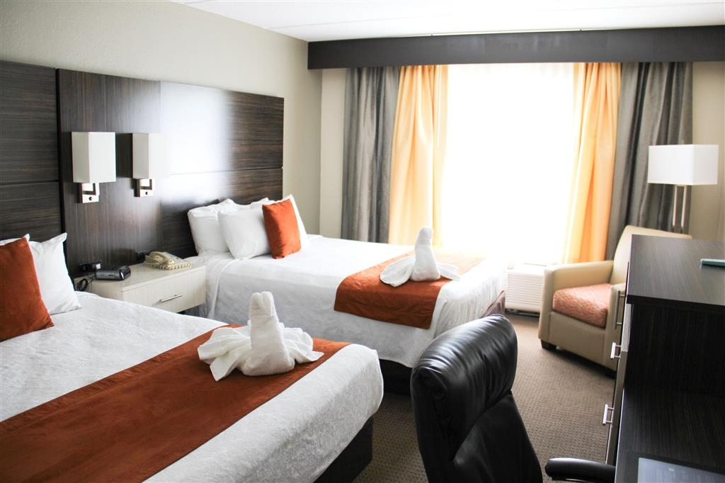 Best Western Airport Inn & Suites - Contemporary decor on our standard two queen bed guest rooms.
