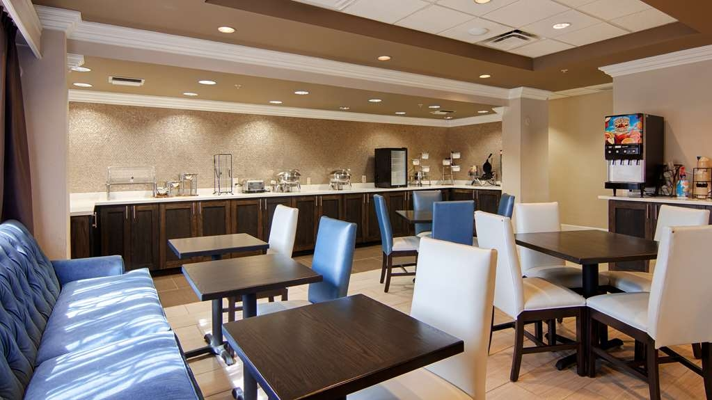 Best Western Airport Inn - Hot breakfast buffet is served daily from 6a.m.-10a.m. in our beautiful breakfast area. Coffee is available 24/7 as well!