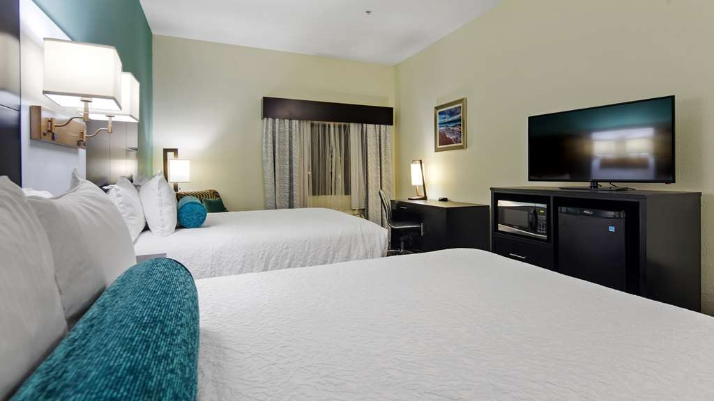 Best Western Mayport Inn & Suites - Family room with two queen beds provides 315 square feet of space with full Hi-Definition television, microwave, refrigerator, iron and ironing board, coffee maker and hair dryer. Accommodates up to 5 comfortably.