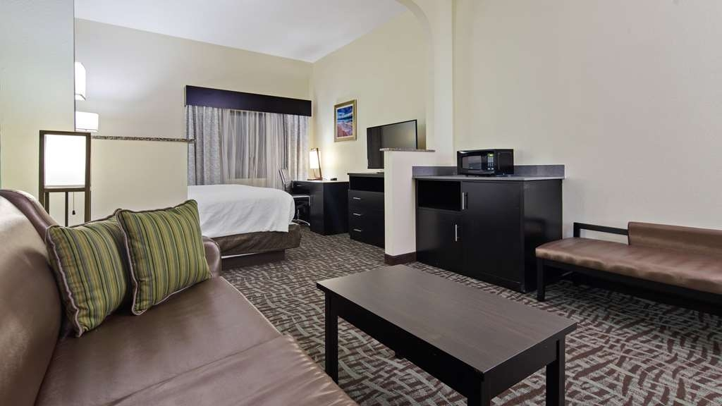 "Best Western Mayport Inn & Suites - The King Suite provides 325 square feet of space and includes a seating area with a sofa with a full-sized pull out mattress, full hi-definition 43"" HDTV, microwave, refrigerator, iron and ironing board, coffee maker and hair dryer."