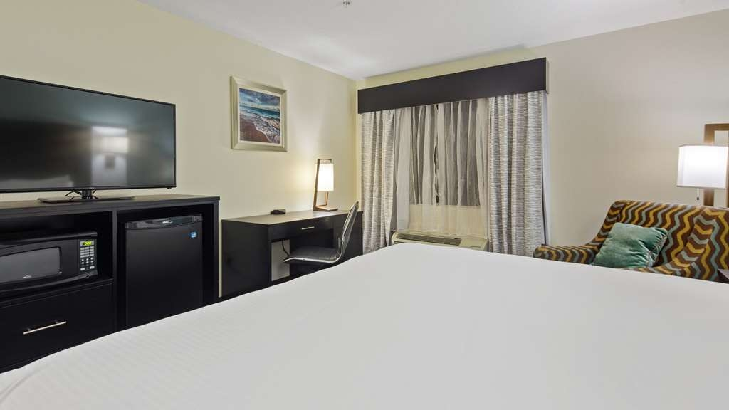 """Best Western Mayport Inn & Suites - The Single King ADA Accessible room provides 315 square feet of space, with either a roll-in shower or standard tub, 43"""" HDTV with full HD channel lineup, microwave, refigerator, iron and ironing board, coffee maker and hair dryer."""