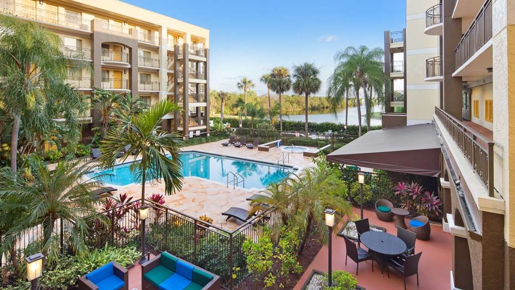 Best Western Plus Deerfield Beach Hotel & Suites - Soak up the sun and take in our beautiful landscape while relaxing in our outdoor pool.