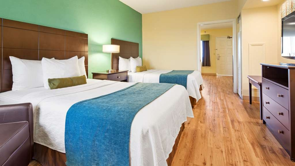 Best Western Plus Deerfield Beach Hotel & Suites - Use the separate living room in our suite 2 double mobility accessible room for entertaining, and keep your sleeping area private.