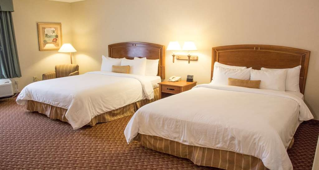 Best Western Plus Kendall Hotel & Suites - Double Queen Mobility Accessible Guest Room comes equipped with a mini-fridge and coffee station. Additional amenities includes a spacious working desk, complimentary Wi-Fi, Iron/Ironing board.