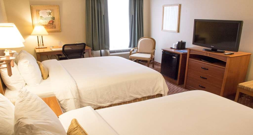 Best Western Plus Kendall Hotel & Suites - Relax after a long day of travel in our Double Queen guest room. Equipped with a mini fridge. In-room coffee maker, Iron/ironing board, safe and complimentary Wi-Fi.