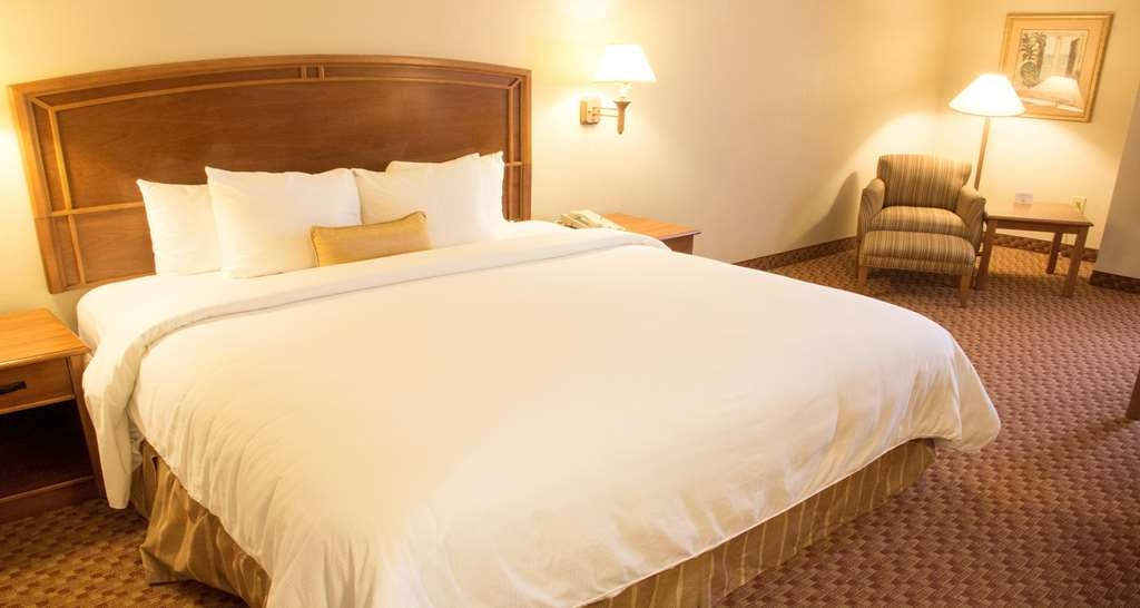 Best Western Plus Kendall Hotel & Suites - Standard King Guest Room comes equipped with a mini-fridge and coffee station. Additional amenities includes a spacious working desk, complimentary Wi-Fi, Iron/Ironing board.