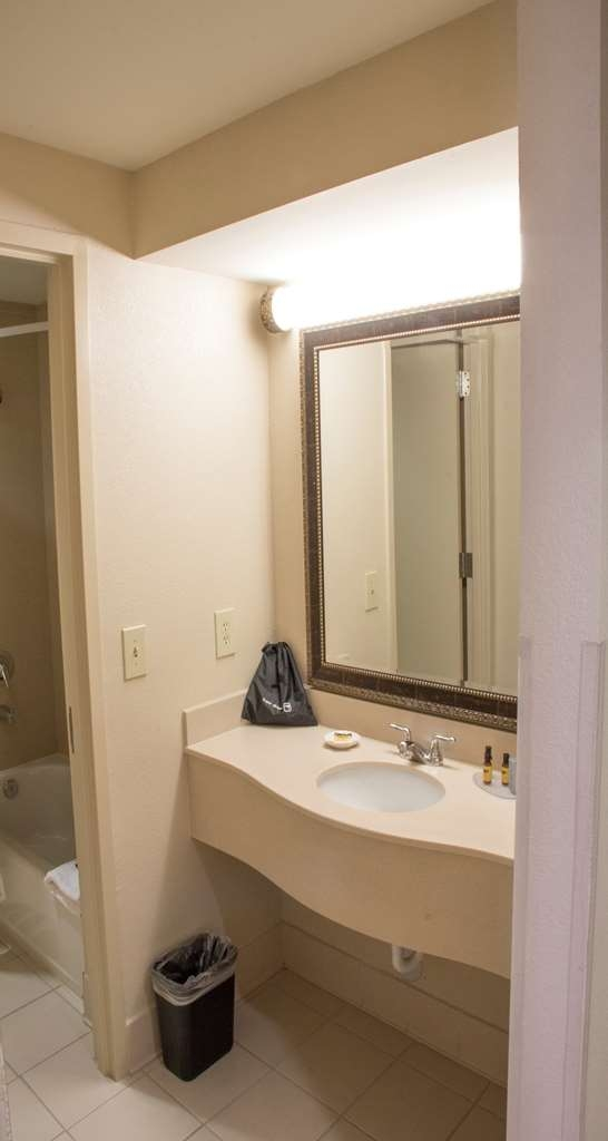 Best Western Plus Kendall Hotel & Suites - Guest Bathroom has a spacious vanity adjacent to the bathroom area.