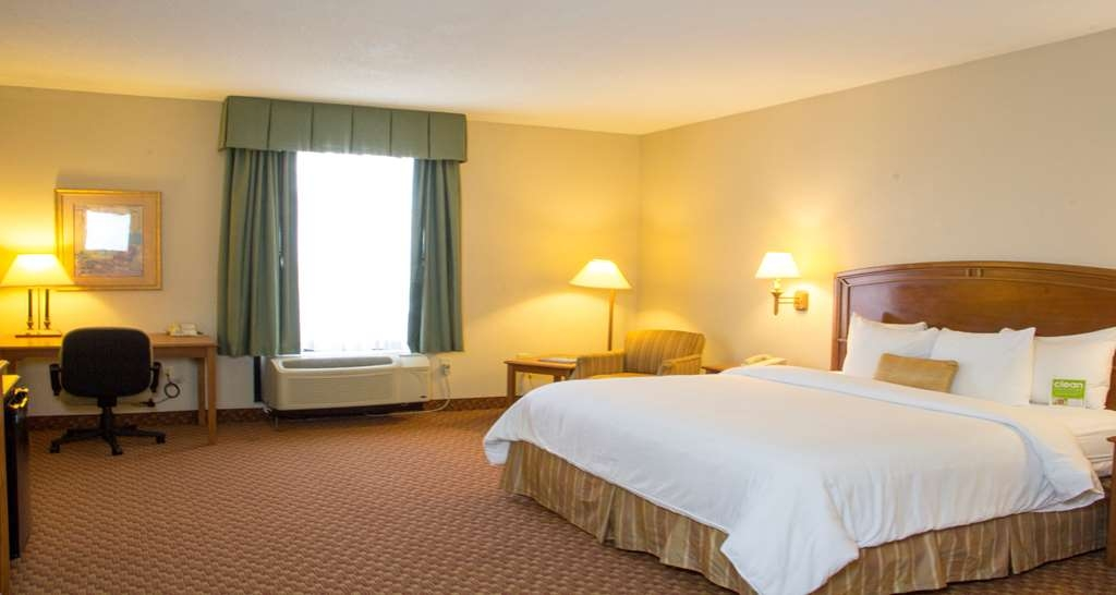 Best Western Plus Kendall Hotel & Suites - King Mobility Accessible Guest Room comes equipped with a mini-fridge and coffee station. Additional amenities includes a spacious working desk, complimentary Wi-Fi, Iron/Ironing board.