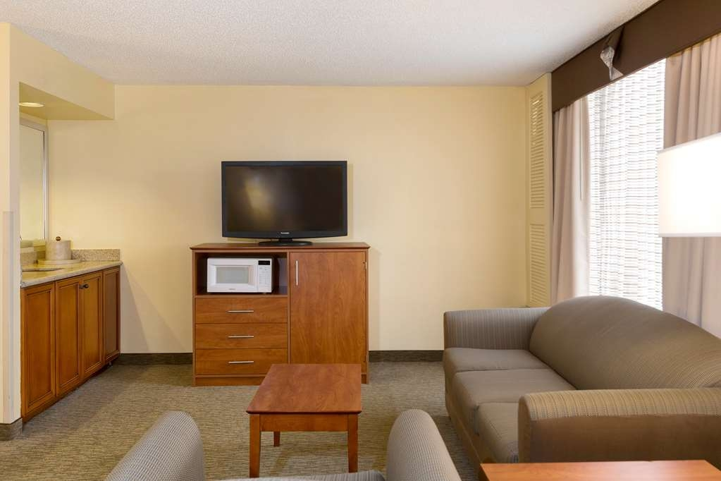 Best Western Orlando Gateway Hotel - Spend some time after a hectic day in the living room featured in our suites.