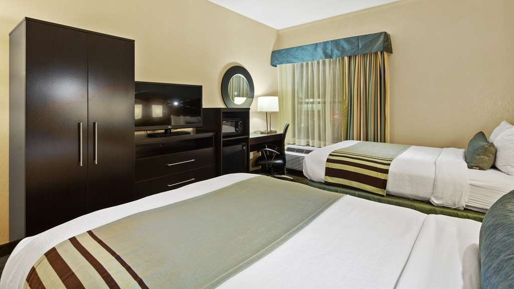 Best Western Plus Tallahassee North Hotel - Two queen size beds and an LED TV? Check. Fridge, Microwave, and Desk? Check. ADA compliant? Awe yeah.