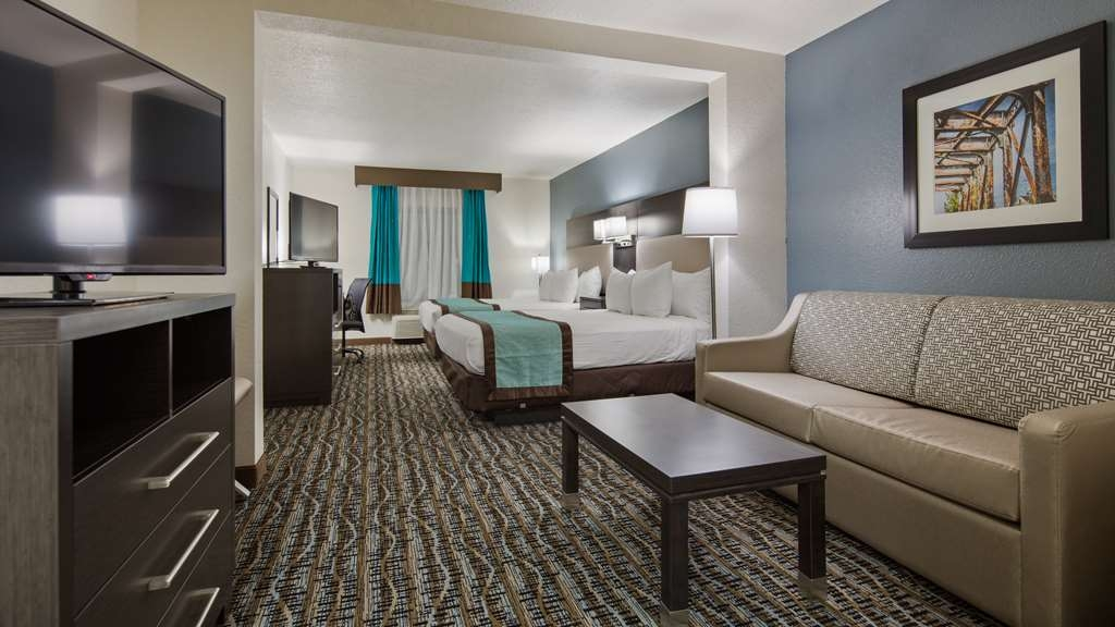 "Best Western Waldo Inn & Suites - Our Double Queen Suite features 2 43"" Televisions, one for you, one for the kids."