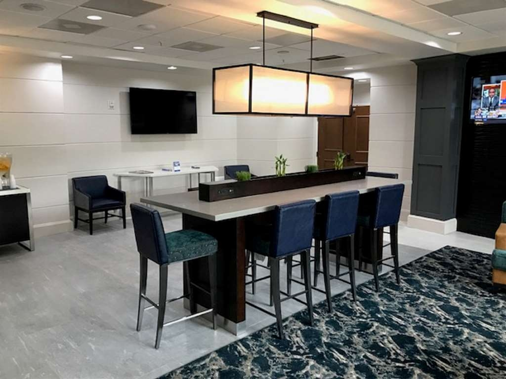 Best Western Premier Jacksonville Hotel - High top table with mobile phone connections