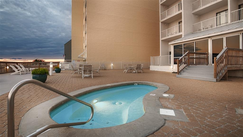 Best Western on the Beach - Relax and feel at home with a swim in outdoor hot tub.