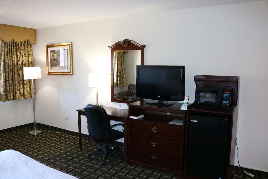 Best Western Milton Inn - One king size bed non smoking in the interior corridor building with balcony facing the hwy. Come with love seat, coffee table, business desk and mini micro/fridge.