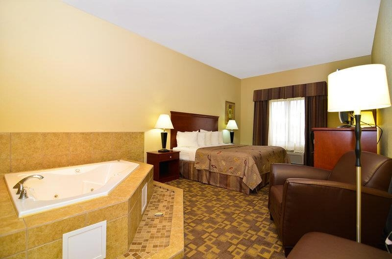 Best Western Opp Inn - Spend a special night together in our King Suite with Hot Tub.