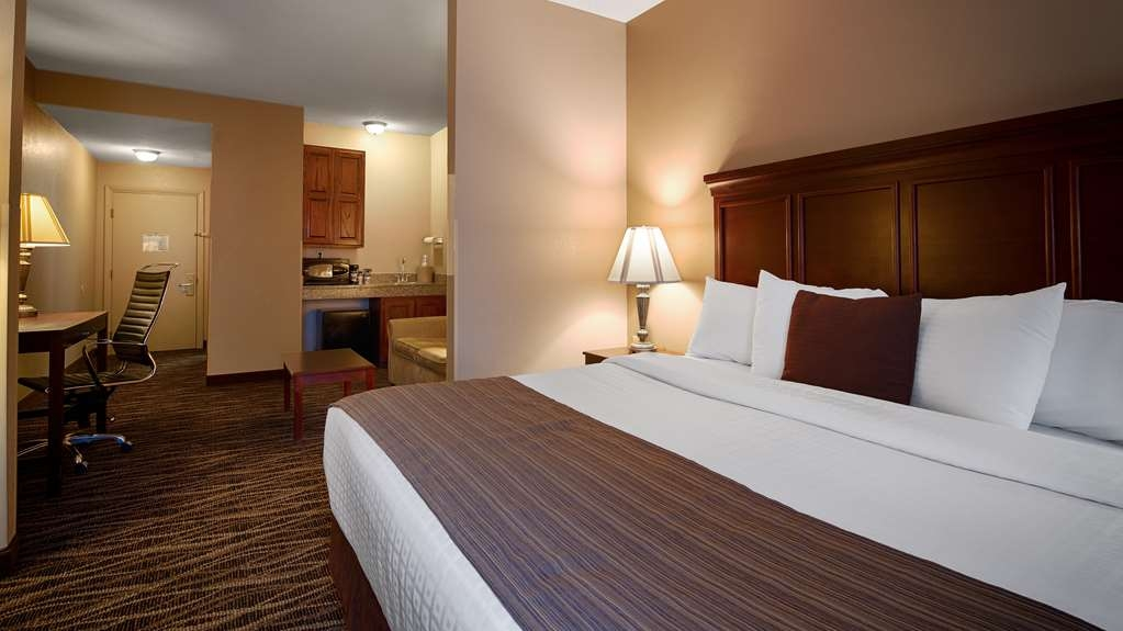 Best Western Plus Russellville Hotel & Suites - Executive room features expanded living space, plush Simmons® Beautyrest® pillow top mattress, and 40-inch HD flat panel television.
