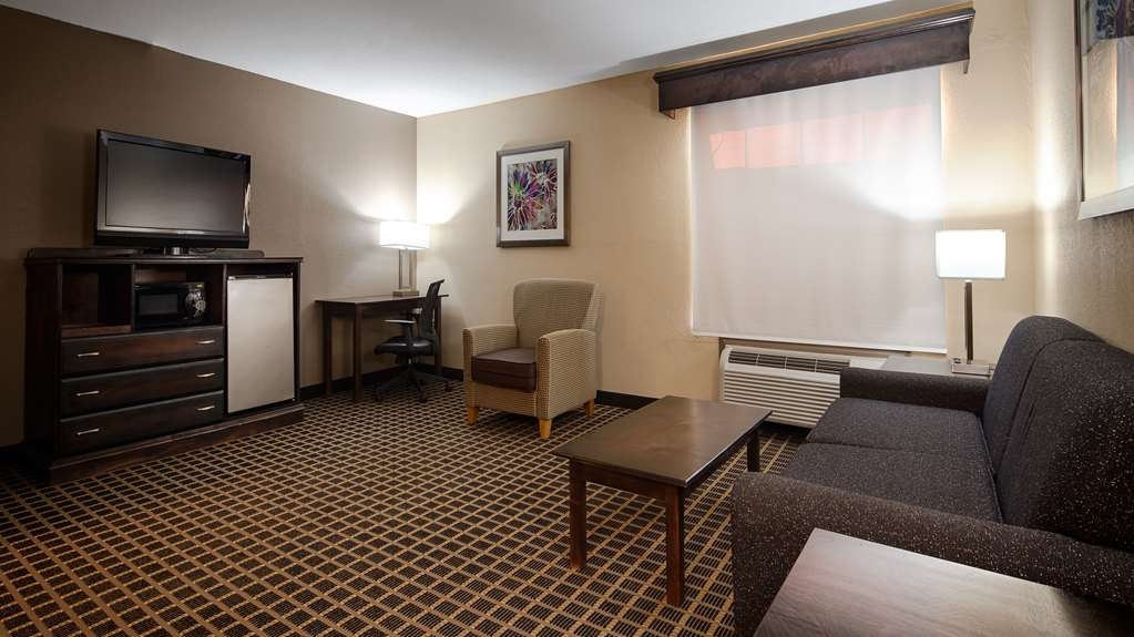 Best Western Allatoona Inn & Suites - Settle in for the evening and relax in our roomy suite living area.