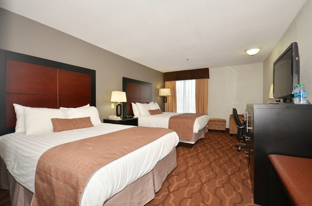 Best Western Commerce Inn - Two Queen Beds with Comfortable Chair and Ottoman