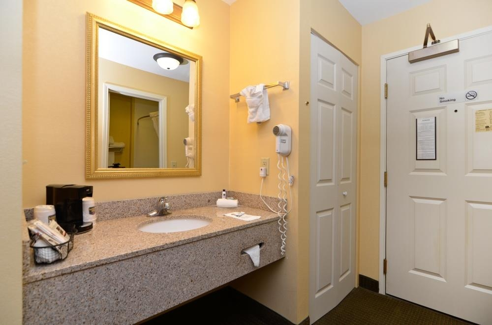Best Western Plus Bessemer Hotel & Suites - 2 Queen Guest Bathroom - All guest bathrooms have a large vanity with plenty of room to unpack your necessities.