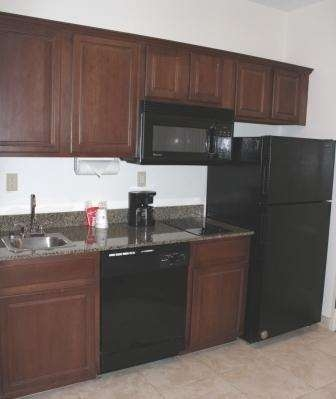 Best Western Plus Valdosta Hotel & Suites - Full Kitchens include a full size refrigerator, 4 sets of dishes, pots and pans, 2 stovetop burners, and a dishwasher.