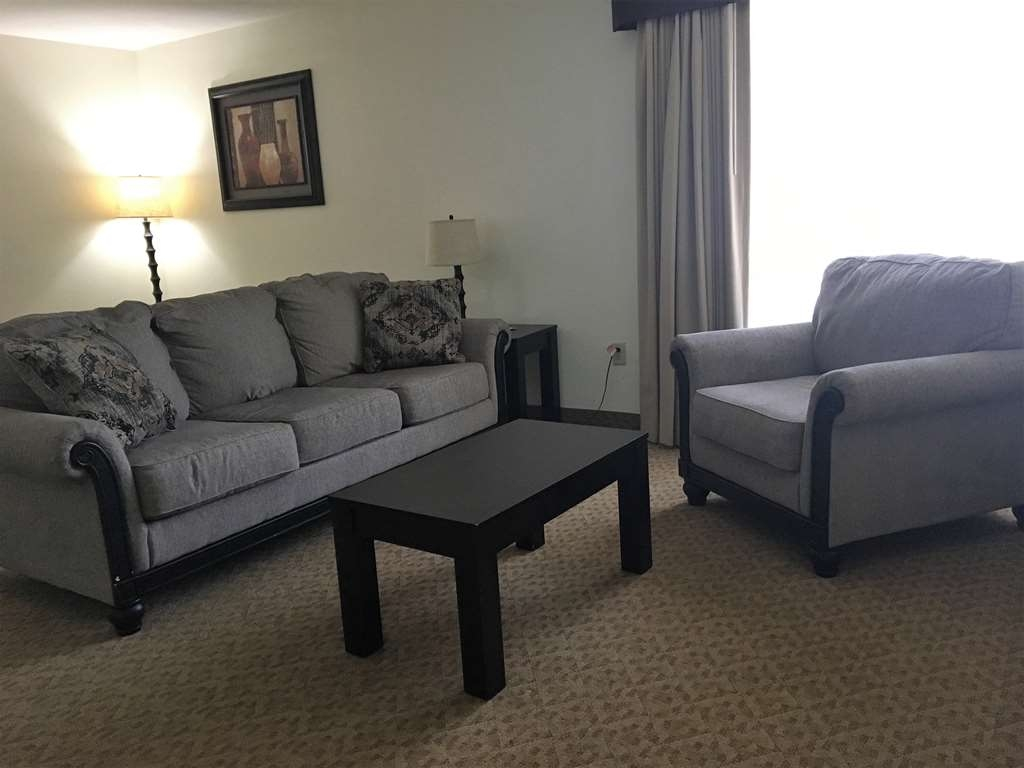 Best Western Plus Valdosta Hotel & Suites - Exe Sitting Area with pullout sofa. Come relax and unwind comfortably.