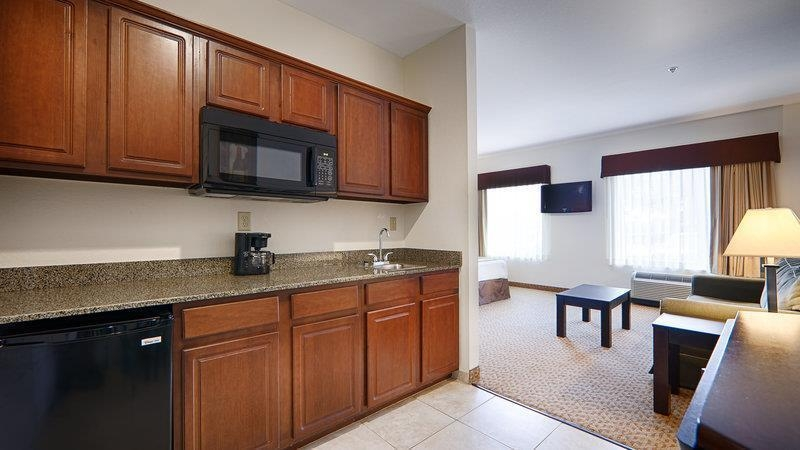 Best Western Plus Valdosta Hotel & Suites - Small refrigerator, microwave, coffeepot, sink, and table