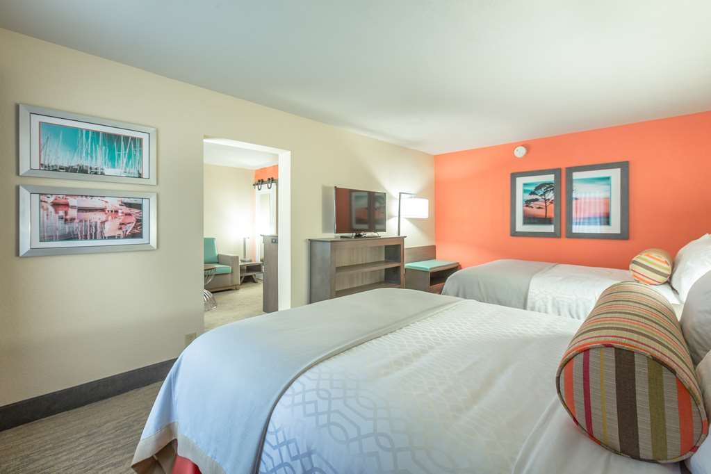 Best Western Plus St. Simons - Pull back the covers, hop in and catch your favorite TV show in our 2 queen suite.
