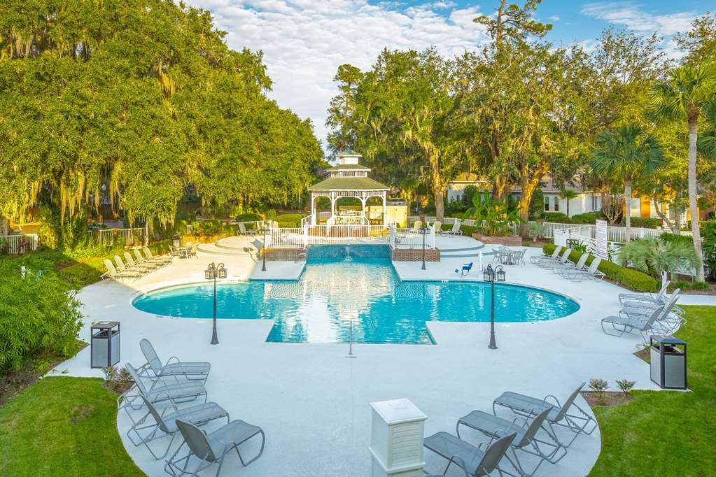 Best Western Plus St. Simons - Enjoy our beautiful pool and spa area shaded by majestic live oaks.