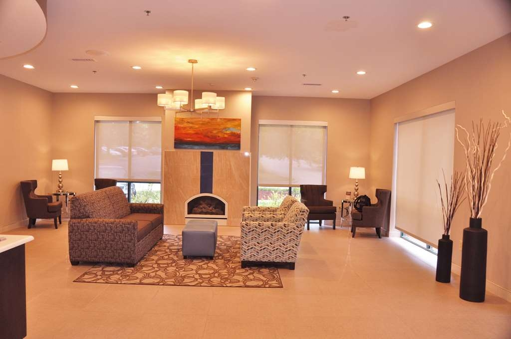 Best Western Plus Roswell/Alpharetta - Stay warm by the fireplace or settle into one of the comfortable chairs.