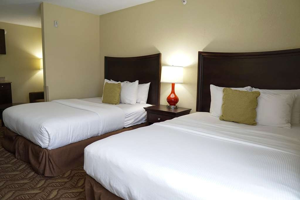Ecco Suites, BW Signature Collection - Studio Suite Bedroom Area with Two Queen Size Beds and a Living Area