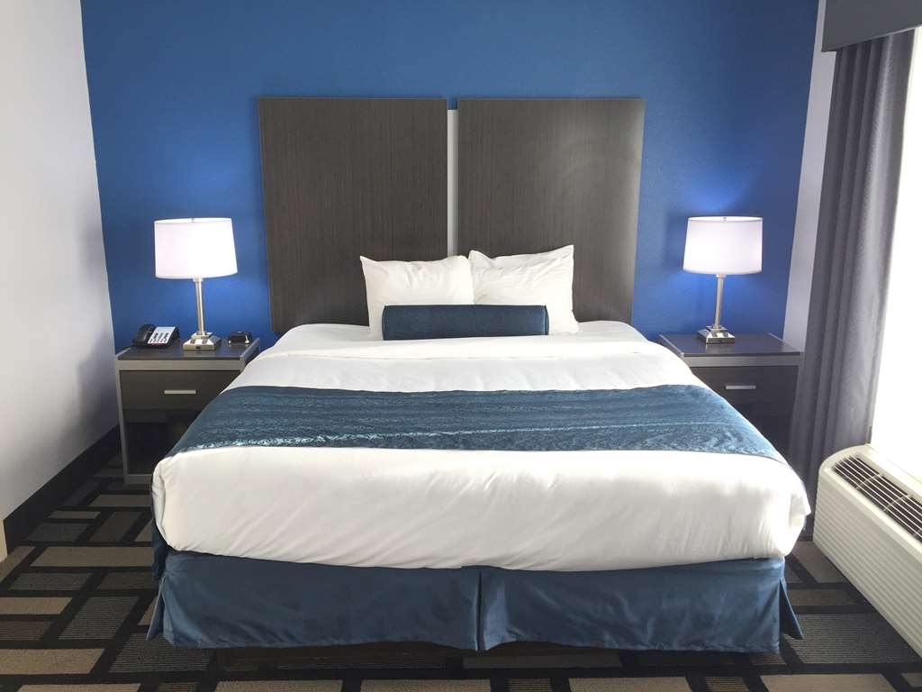 Best Western Plus Birmingham Inn & Suites - Deluxe King with Kitchenette sleeps one to three people.