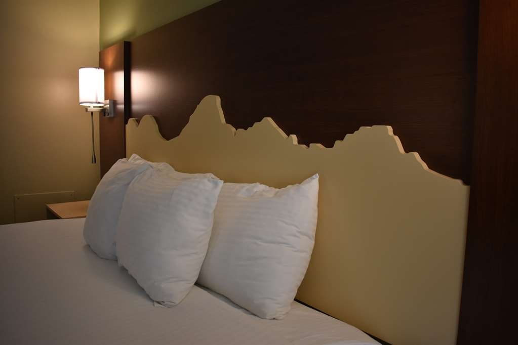 Best Western Driftwood Inn - Our King Balcony rooms have custom Grand Teton headboards and a balcony with a view of the Snake River.