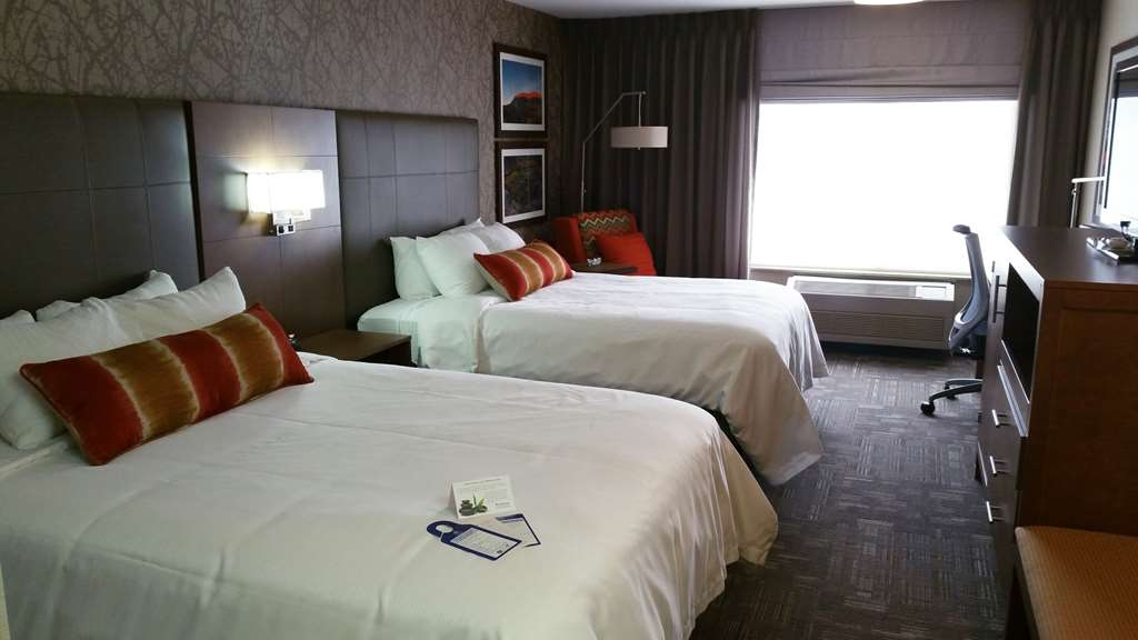 Best Western Plus CottonTree Inn - Two queen beds with workstation, 40-inch HD wall mounted TV, new bedding package including duvet covers and curved shower rods.