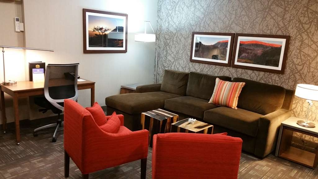 Best Western Plus CottonTree Inn - Our king suite has one king size bed, 40-inch HD wall mounted TV, a large bathroom with lighted vanity and more.