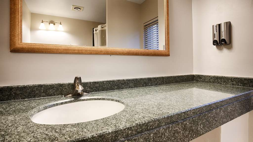 Best Western Plus Oakbrook Inn - All guest bathrooms have a large vanity with plenty of room to unpack the necessities.