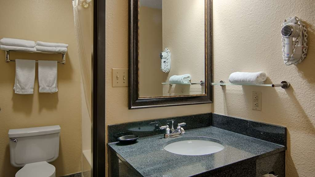 Best Western U. S. Inn - All guest bathrooms have a large vanity with plenty of room to unpack the necessities.