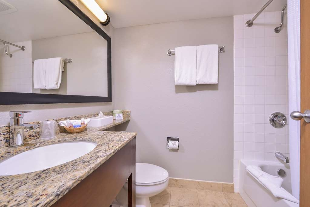 Best Western Naperville Inn - Our guest bathrooms are both tubs and showers for your convenience. We have marble top sinks and modern bottoms to make beautiful atmosphere.