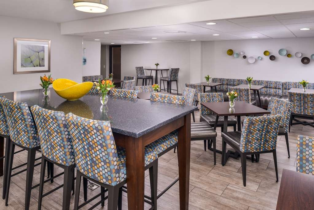 Best Western Naperville Inn - Our newly renovated breakfast room has plenty of seating. We have booths, tables and a harvest table that you can plug your electronics into to charge while you work. We also have two 38 inch flat screen T.V.'s for your use.