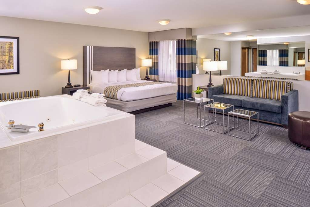 "Best Western Naperville Inn - Our Presidential Suite with King bed features a Whirlpool and a 55"" TV with Sitting Area."