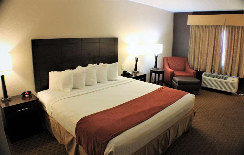 Best Western Lorson Inn - King Guest Room with comfortable chair, ottoman, and work desk.