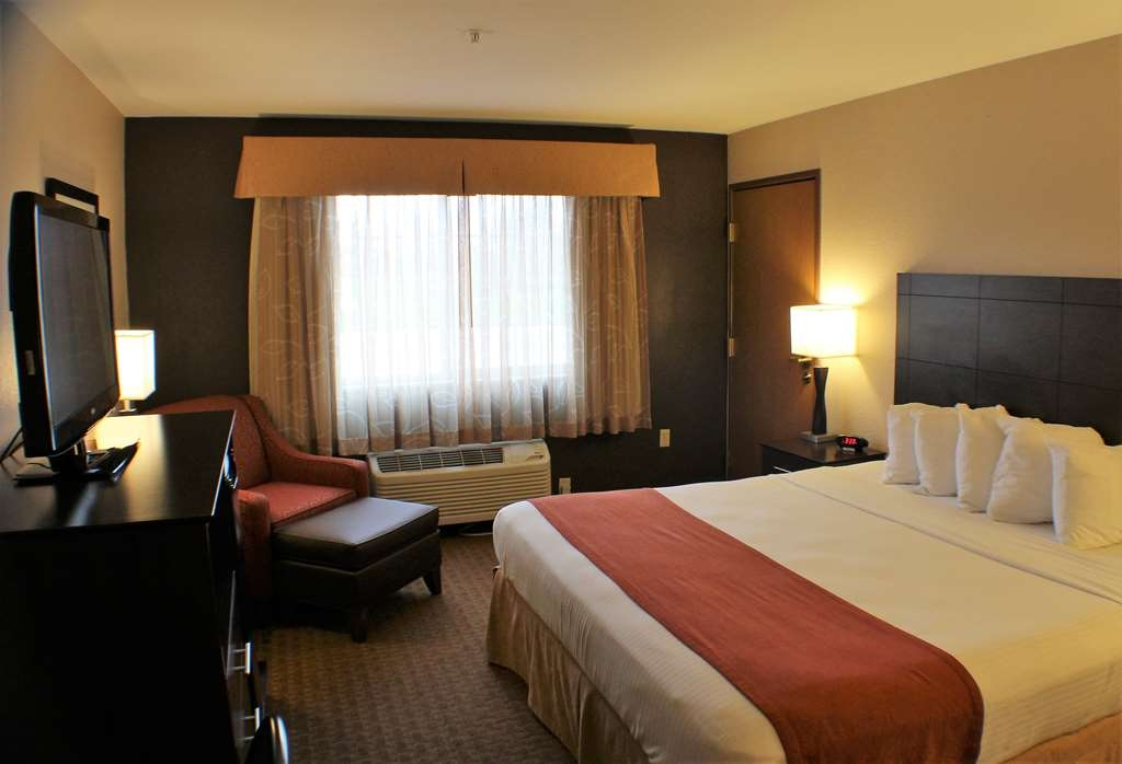 Best Western Lorson Inn - King ADA Mobility Accessible Room with comfortable chair, ottoman, and work desk.